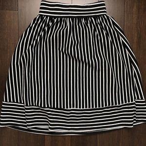 Black and white striped midi skirt.